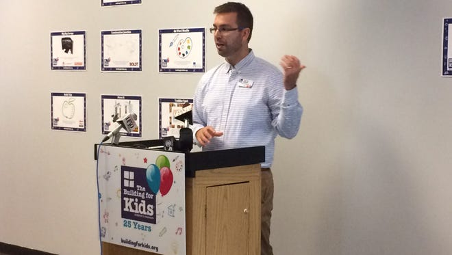 Jarrad Bittner, executive director of The Building for Kids Children's Museum, announces plans to update and expand exhibits.