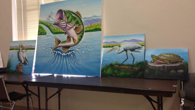 Canvases of a pelican, bass, egret, and turtle painted by Ralph Stearns are seen at a September Lake Wichita Revitalization Committee meeting. The pieces are part of a potential large mural on the Lake Wichita Spillway.
