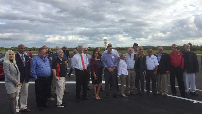 Officials from Brevard County and the cities of Palm Bay and West Melbourne, commemorate the opening of a 3.1 mile segment of the St. Johns Heritage Parkway.