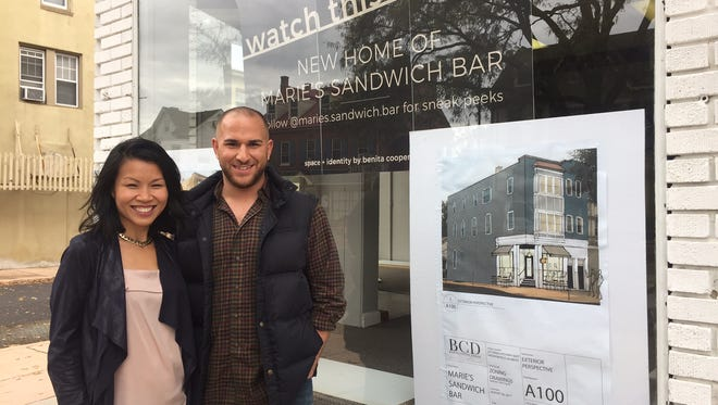 The future look of Marie's Sandwich Bar is shown on a sign outside the new location in Haddonfield, where architect Benita Cooper and Nick Capaldi have forged a friendship.