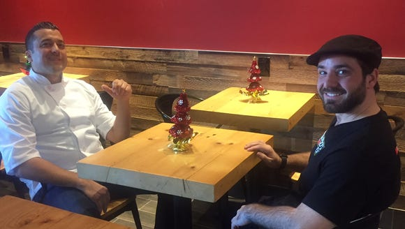 Chef/restaurateur Jim Marino sits with franchisee Mike
