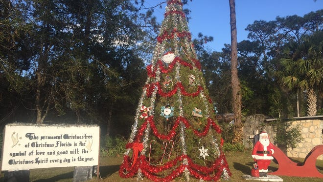 A permanent community Christmas tree anchors a yuletide scene at the northeast corner of State Road 50 and Fort Christmas Road, in Christmas, Florida.