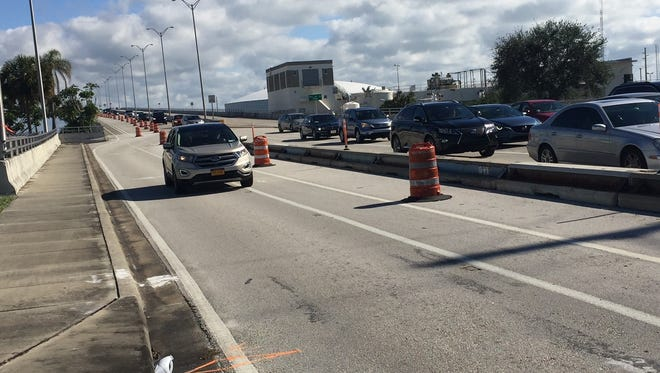 Cars westbound on the Alma Lee Loy Bridge line up near the intersection of Indian River Boulevard Dec. 10, 2017. Penny Chandler, president of the Indian River County Chamber of Commerce, is among people worried about westbound motorists' safety during construction of a widened shoulder on 17th Street expected to last until August 2018.