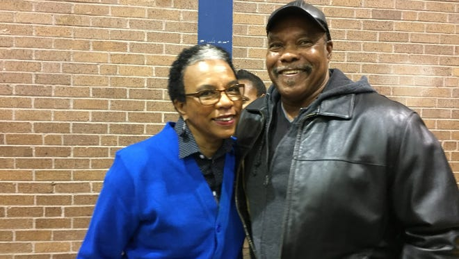 Woodlawn counselor Elizabeth Sullivan smiles with Husher Calhoun, who coached for 42 years at three Shreveport schools.