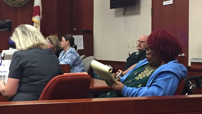 Wanda White-Scott,  a business owner and activist in Gifford, takes notes during closing arguments of her trial on perjury charges Feb. 8, 2018, at Indian River County Courthouse. White-Scott was convicted of first- and second-degree misdemeanors for filing a complaint that wrongly claimed a deputy didn't have his patrol car lights on while helping citizens jump a vehicle in Gifford