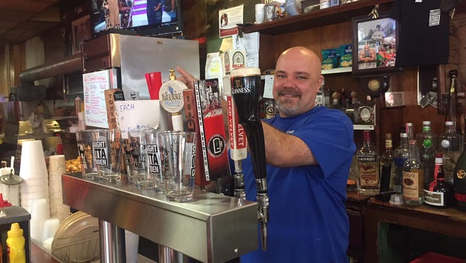 Donkey's Place owner Rob Lucas Jr. mans the taps at the bar and restaurant on Haddon Avenue in Camden. The business, celebrating its 75th year, is about to launch a food truck and will be featured in the March 7 episode of 'The Goldbergs' on ABC.