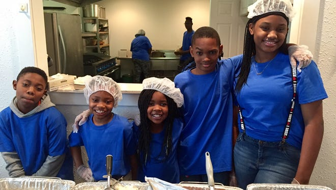 Triston Lewis, Jayla Moore, Taliyah Lewis, Jamal Moore and Kaylen Shane are ready to serve breakfast at Temple of Believers Deliverance Church.