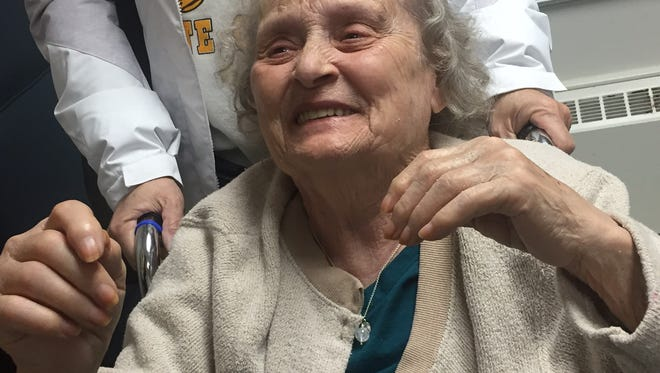 Helen Harney, who has vascular dementia, reacts happily to seeing her son-in-law, Doug Kennerly.