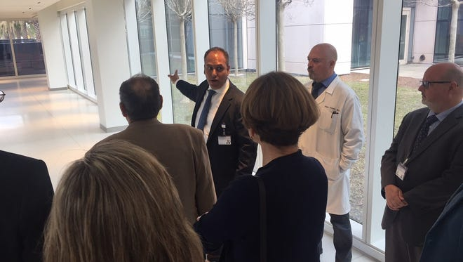 Dr. Wael Barsoum, CEO of Cleveland Clinic Florida, points while leading Indian River County Hospital District trustees on a tour of his company's hospital in Weston March 5, 2018.