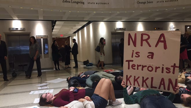 Students from Florida A&M University and Florida State University and others staged a die-in while the Florida House debated a school safety bill that arms classroom teachers.