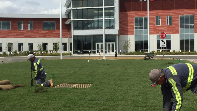 Workers planted the last of the sod in front of the new Rowan College at Burlington County Center in Mount Laurel when that location became its  main campus in September.