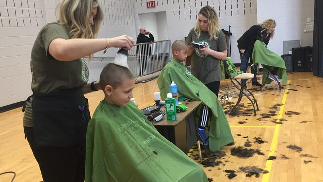 Let the shearing begin at the 4th annual St. Baldrick's fundraiser at Kennedy Elementary School in Succasunna on Friday, March 16, 2018.