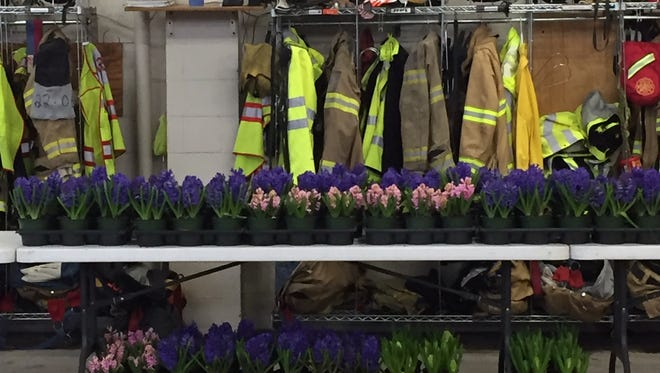 Volunteers stocked Lebanon Fire Station One with flowers on Tuesday in anticipation of the annual Easter sale.