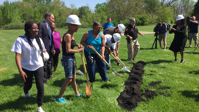 Indianapolis Mayor Joe Hogsett (left) watches as residents of Carriage House East help break ground on the new Success Center to be built at the far-eastside apartment community. The center is funded by Glick Philanthropies.