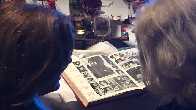 Reviewing yearbooks is a staple at any class reunion, such as the 40th held for the Vero Beach High School  Class of 1978, June 30, 2018, at Quail Valley River Club.
