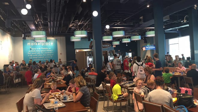 Adventure Aquarium's new Marketplace dining space offers a mix of retro and modern, with reclaimed wood and mid-century accents. Guests can get made-to-order and grab-and-go items.