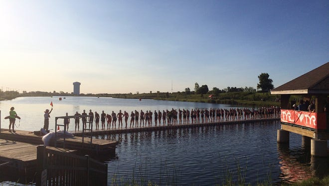 The USA Triathlon Youth and Junior National Championships will be this weekend at Voice of America Park in West Chester Township. Pictured is the Junior Girls Elite Group mass start at the lake from a previous year.