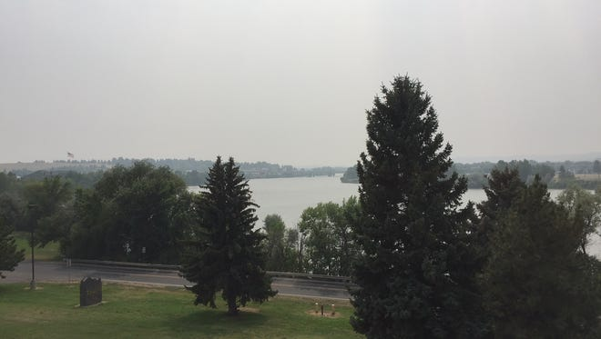 Smokes hangs over the Missouri River and Great Falls last Sunday. Air quality is expected to continue to deteriorate late Thursday and into Friday.
