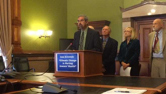 David Courard-Hauri, associate professor with the Environmental Science and Policy Program at Drake University, shares the Iowa Climate Statement 2014 in the Iowa State Capitol Friday morning.