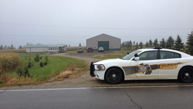 A Sanilac County Sheriff Department patrol car is parked in front of the driveway of 2409 Forester Road Monday morning.