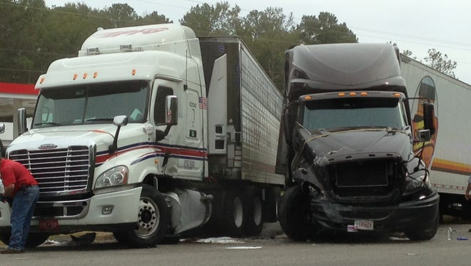 Collision between two 18 wheelers, blocking one lane of Highway 231, close to the Highway 82 intersection.