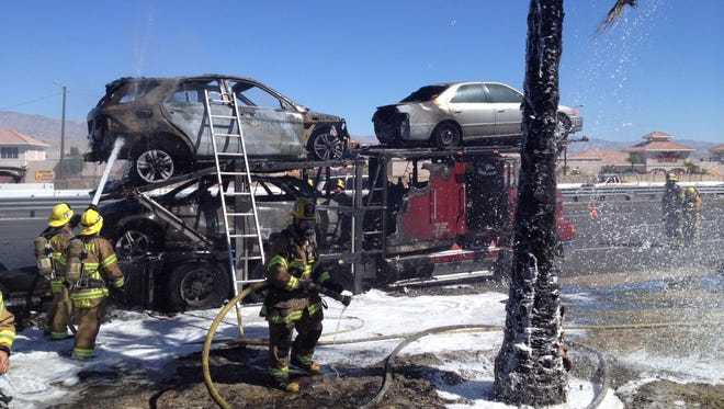 A big rig carrying cars caught fire about 11:50 a.m. Tuesday, blocking traffic and an onramp.