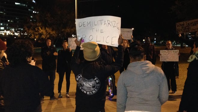 Protesters gather in Tempe the night a grand jury returned no indictment in the shooting death of Michael Brown, Nov. 24, 2014.