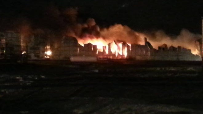 A fire burns at an elevator in Mitchell on Wednesday, Nov. 19, 2014.
