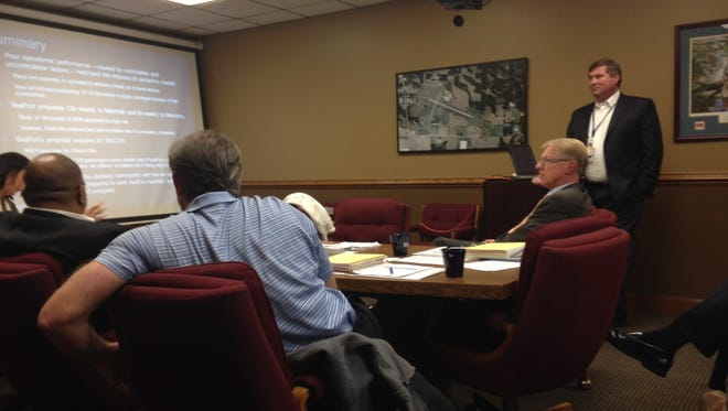 Rob McKinney, right, presents to the Airport Authority Board Monday night to keep SeaPort as the carrier in Jackson.