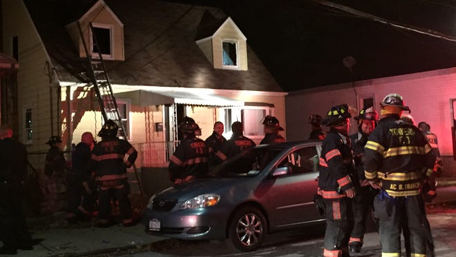 Firefighters at 37 Dunbar St. in Yonkers, where a man was found unconscious on the second floor, Oct. 26, 2014.