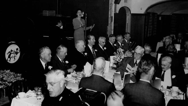 A singer entertains the crowd at Barnard Exempt's Restaurant and Party House in Greece in this circa 1940s or 1950s photo.