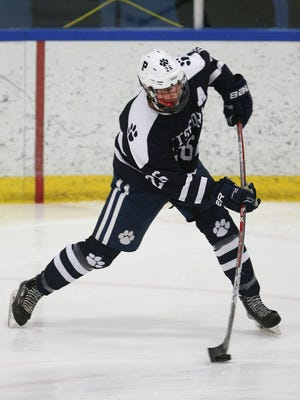 Pittsford's Andy Bronstein takes a wrist shot against Penfield.