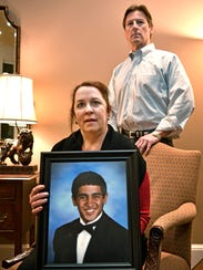 Brentwood resident Liz Beatty and her husband Yarnell pose with a photo of their son, Alex, on Feb. 13, 2018. Alex Beatty died from an accidental drug overdose in 2016.