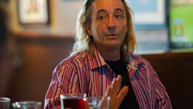 Gregory Smith, owner of Chef Gregory Food Truck, speaks during a meeting of local food truck owners at the Corner Bar in Lafayette, LA, Monday, Jan. 26, 2015.