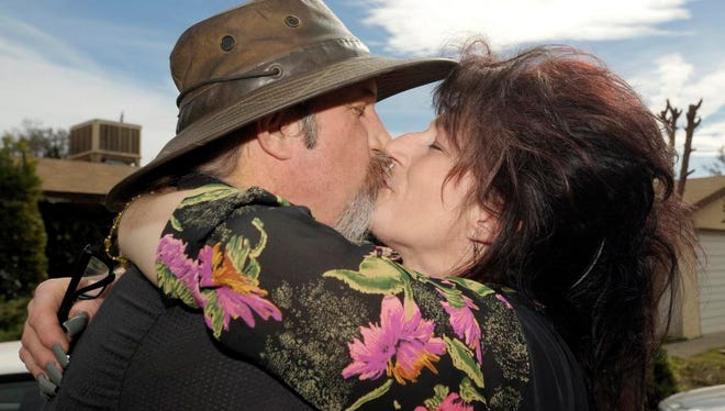 Gwen Young and her husband, Cassidy Scroggins met on a blind date back on March 27, 1998. They have been together ever since. Pictured near their home in north Visalia.