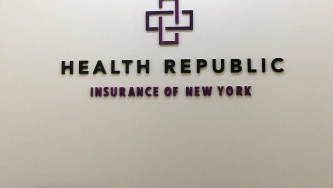 In this photo taken on Wednesday, Nov. 18, 2015, a business logo adorns the wall outside the offices of Health Republic Insurance of New York. The collapse of Health Republic, by far the largest nonprofit health insurance cooperative created under the Affordable Care Act, is having repercussions throughout New York.