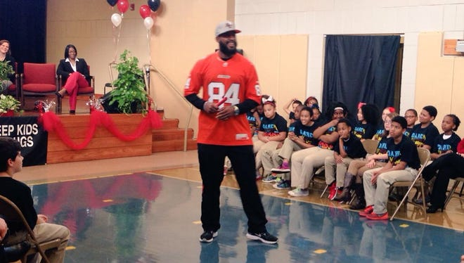 """Emmanuel """"Manny"""" Arceneaux, former Peabody Magnet High School wide receiver who now plays for the Canadian Football League BC Lions, speaks to Rosenthal Montessori Elementary fifth-graders and their parents at a D.A.R.E. graduation Thursday."""