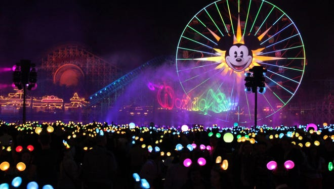 """In this handout photo provided by Disney Parks of """"World of Color - Celebrate"""", Disneyland Resort celebrates its 60th anniversary with a preview of its three new nighttime spectaculars, """"Disneyland Forever"""", """"Paint The Night"""" and """"World of Color - Celebrate"""" on January 28, 2015 in Anaheim, California."""