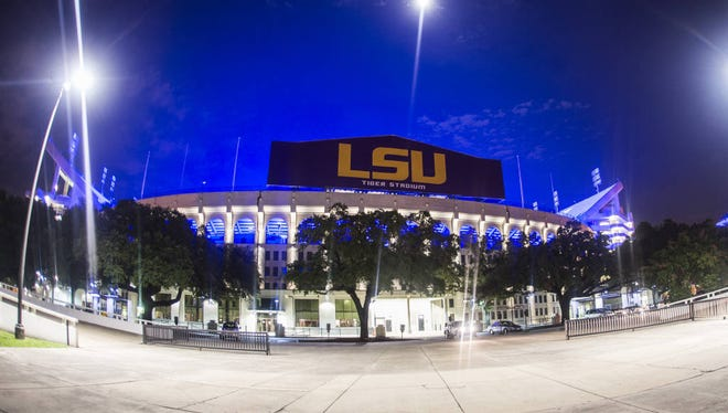 LSU's Tiger Stadium was lit in blue to honor three slain Baton Rouge area law enforcement officials in July.