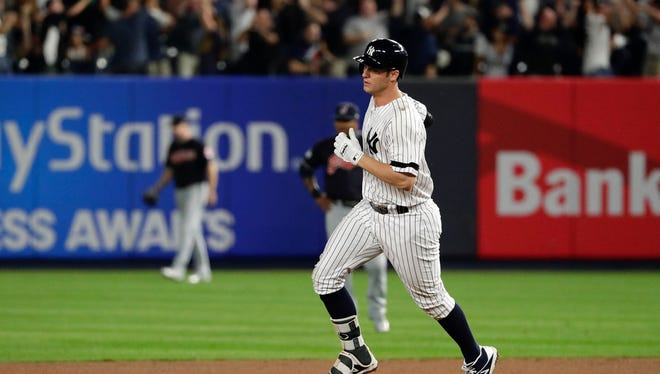 Greg Bird rounds the bases after his homer