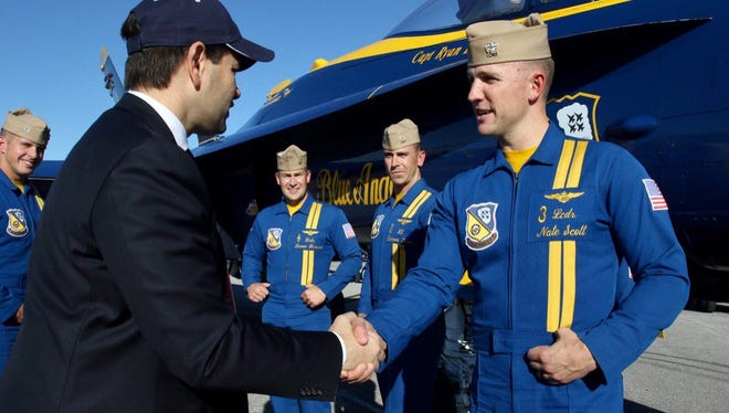 Sen. Marco Rubio, R-Florida, meets Friday, Nov. 10, 2017, with Blue Angels pilots at the 2017 Blue Angels Homecoming Show.