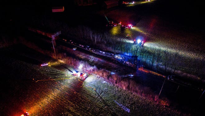 This photo provided by Nicholas Waun shows the scene where two trains collided and derailed in Georgetown, Ky., early Monday.