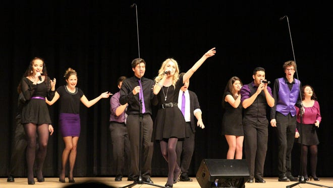 """Students in Cypress Lake High School's a capella performance troupe are going to New York City in April for a """"Pitch Perfect"""" style competition."""