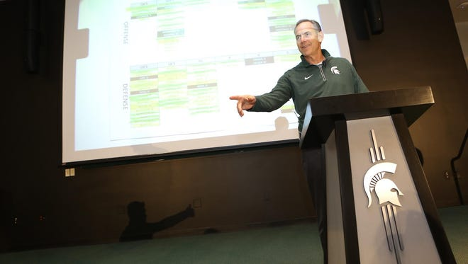 Mark Dantonio watches over the Green-White game player draft on Tuesday.