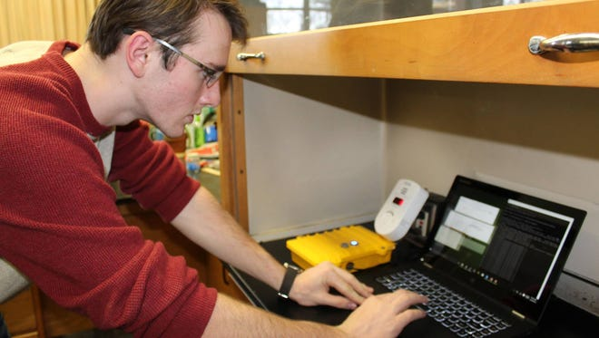 David Blincoe tests his algorithm at Villa Madonna Academy High School.