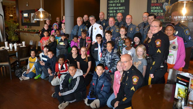 """The past three years, an average of 25 kids from the Smyrna-Clayton area have been able to """"Shop with a Cop"""" at the Middletown Walmart and are treated to lunch or dinner at Pat's Pizza."""