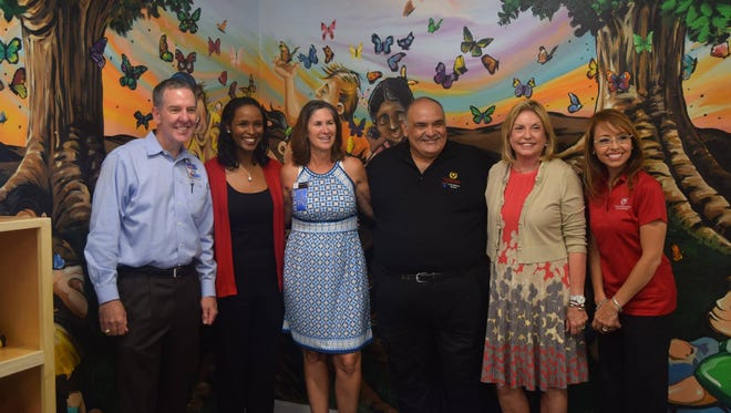 Representatives from H-E-B and Coastal Bend CASA celebrate opening the new children's room