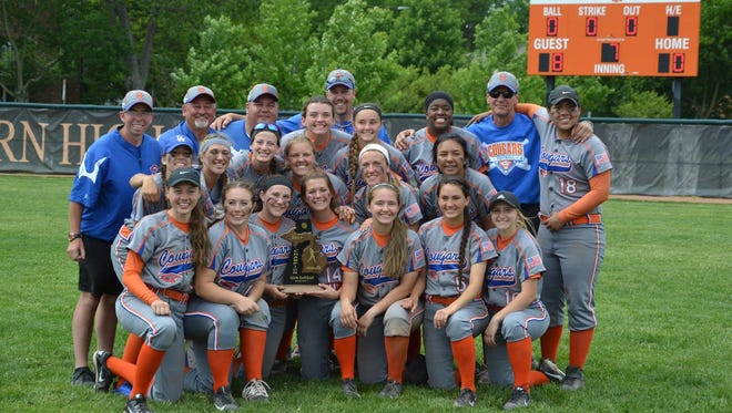 Garden City's varsity girls softball team celebrates after winning the Division 1 district championship at Dearborn.