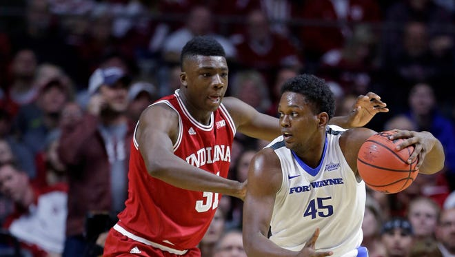 IPFW center Brent Calhoun (45) drives on Indiana center Thomas Bryant (31) in the first half of an NCAA college basketball game in Fort Wayne, Ind., Tuesday, Nov. 22, 2016. (AP Photo/Michael Conroy)