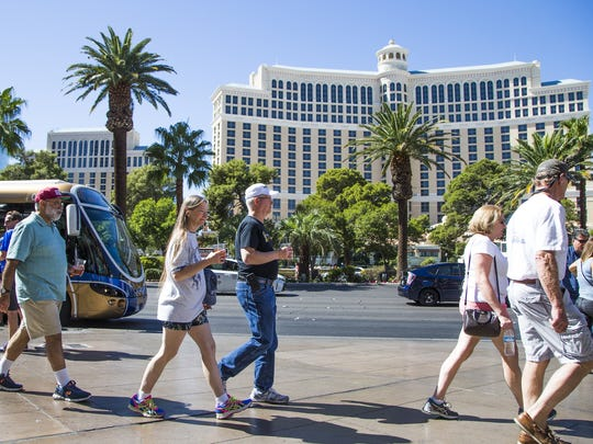 People stroll down Las Vegas Boulevard on Oct. 6, 2017. Moods on the Strip varied almost a week after the mass shooting that claimed 58 lives.